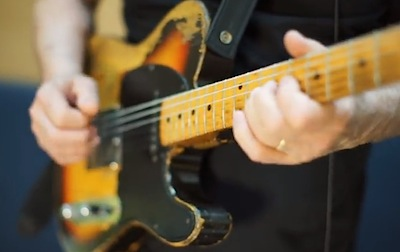David seen using the '55 Fender Esquire while playing the leads on Rattle That Lock.